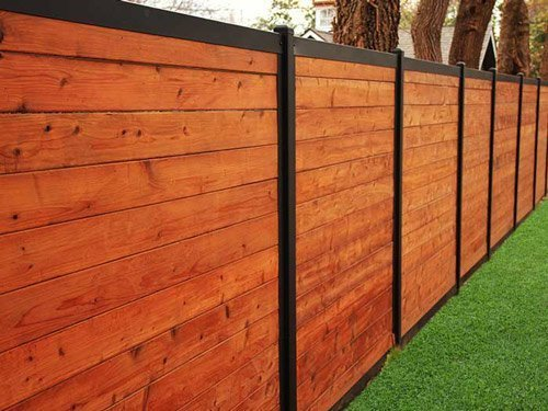 7 Tips on Installing a Fence Around Your Home Stain the Wood