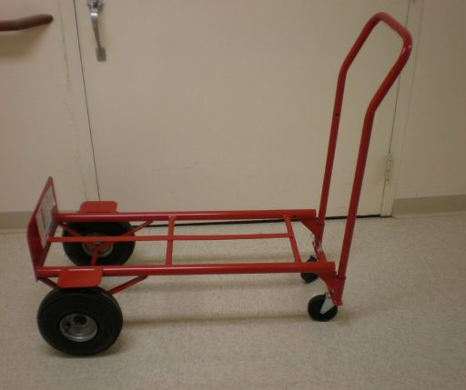 A red hand truck on 4 wheels